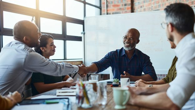 angel investors or venture capitalists coming to terms of investment with a handshake deal
