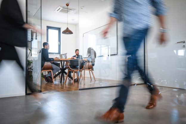 transparent office space with conference room and discussions about the benefits of crowdfunding