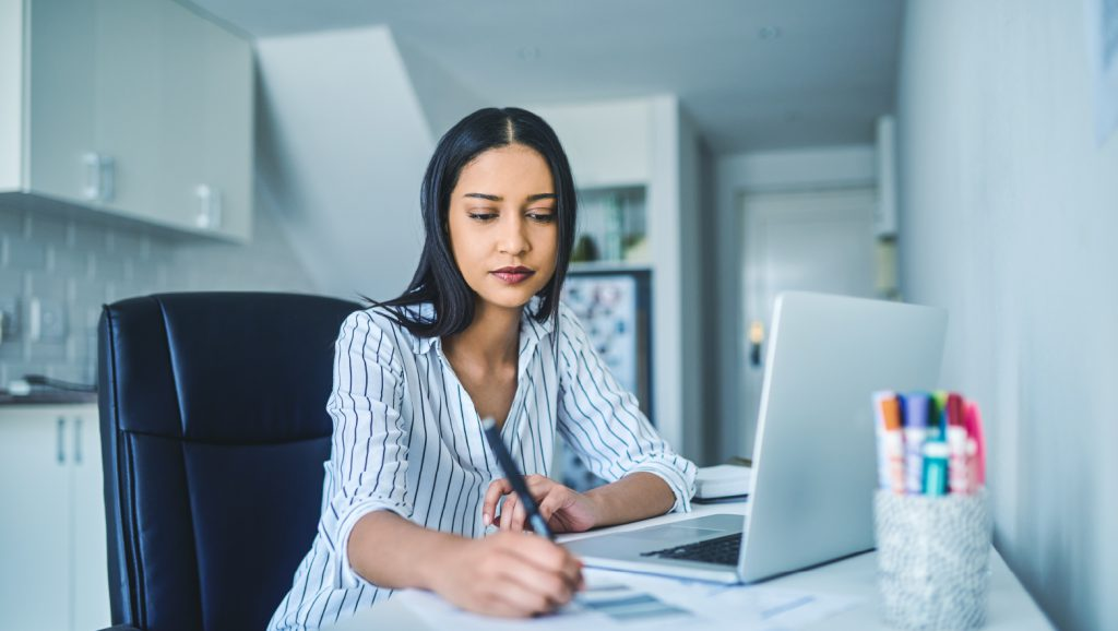 business woman calculating pre and post money valuations for startup business