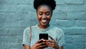 female investor considers high-risk investments on mobile brokerage